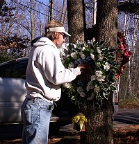 Guy hanging a memorial wreath